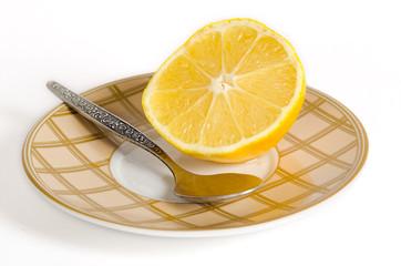 A half of a lemon with a teaspoon