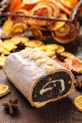 Christmas poppy cake with icing and desiccated coconut on wooden