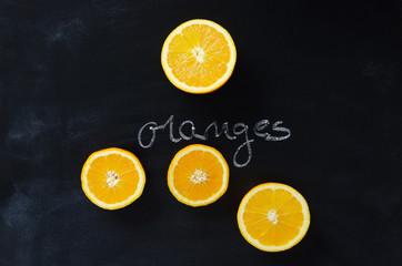 """Orange fruits and handwritten word """"oranges"""""""