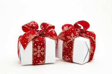 Little gift boxes decorated with ribbons isolated