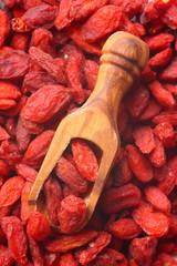 Goji berries in wooden scoop