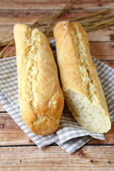 Freshly baked baguettes on wooden boards