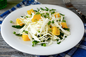 Fresh cabbage salad and orange