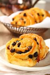Fresh gluten free sweet swirl bun with raisins
