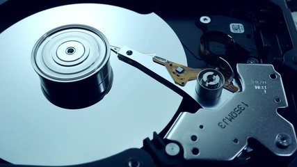 Dolly shot of Hard disk drive with spinning platter