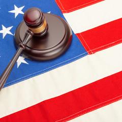 Wooden judge gavel and soundboard - court judgment concept