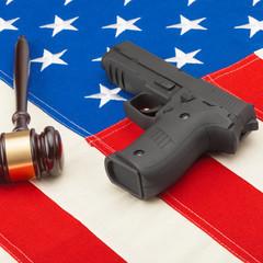 Judge gavel and gun over USA flag - self-defense law concept