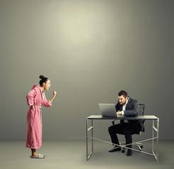 woman screaming at busy husband