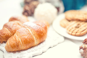 Delicious and tasty fresh croissants as breakfast meal