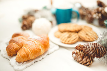 Breakfast in bed with croissants, biscuits, cookies