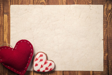 Postcard Valentine's Day. Toy heart shaped handmade with cookies