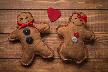 Textile toys in the shape of gingerbread men for Valentine's Day