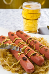 Bavarian fried sausages on sauerkraut