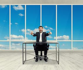 happy businessman sitting
