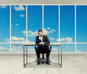 man sitting in the empty office