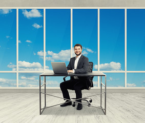 man sitting in the light office