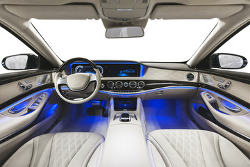 Interior of car. White seats blue ambient light