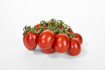 Red ripe tomatoes on green line close up white