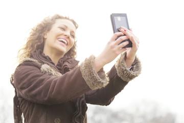 Beautiful young girl taking selfie