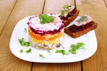 Russian herring salad  and sandwiches