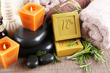 Handmade soap with the branches of rosemary,  spa stones and