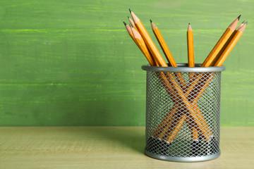 Pencils in metal holder