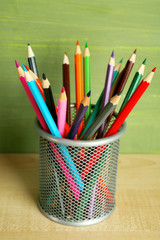 Colorful pencils in metal holder