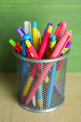 Metal holder with different pens