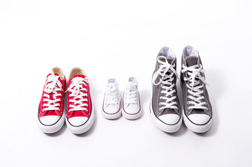 shoes in father big, mother medium and son small kid size