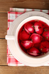 Traditional polish clear red borscht with dumplings