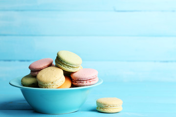 Assortment of gentle colorful macaroons in colorful bowl