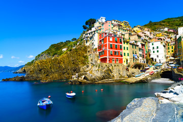 Riomaggiore village, rocks and sea at sunset. Cinque Terre, Ligu