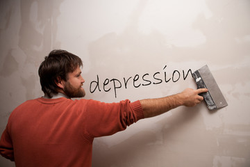 man with a spatula deleting the word Depression
