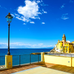 Camogli church on sea, lamp and terrace. Ligury, Italy