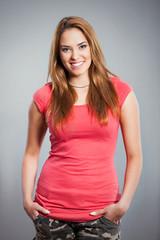 Studio shot of beautiful young woman smiling