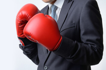 businessman with boxing glove ready to fight with problem, busin