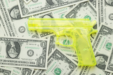 US dollars and pistol