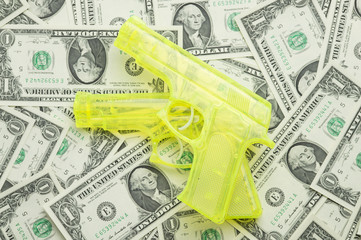 US of 1 dollar and pistol