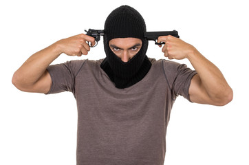 male thief wearing mask and holding guns to his head isolated