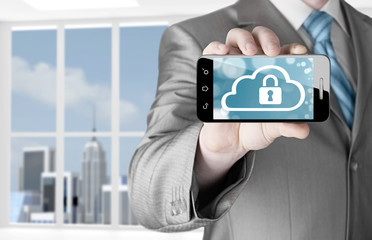 Man holds smart phone with cloud security concept