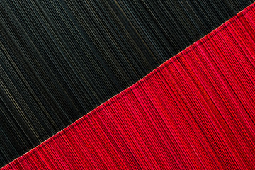 Red and black bamboo mat texture or background