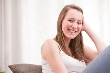 smiling young girl in her living room