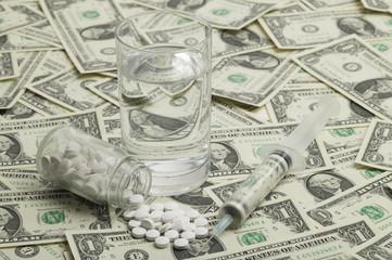 Money, medicine , syringe