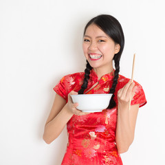 Asian chinese girl eating