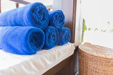 folded blue towel for spa massage