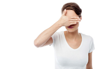 Woman hiding his eyes from light
