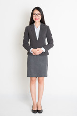 Full body smiling Asian business woman
