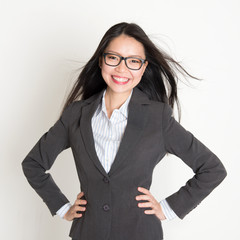 Confident young Asian business woman