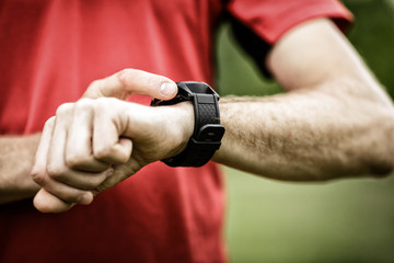 Runner looking at sport watch