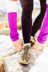 Woman runner tying sport shoe trail running